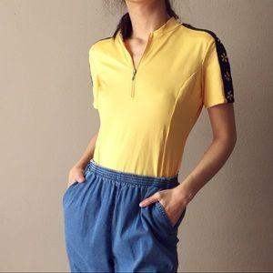 Sugoi stretch yellow top.